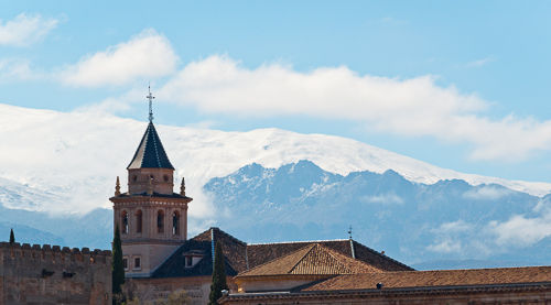 The Alhambra in front of mountains of the Sierra Nevada.