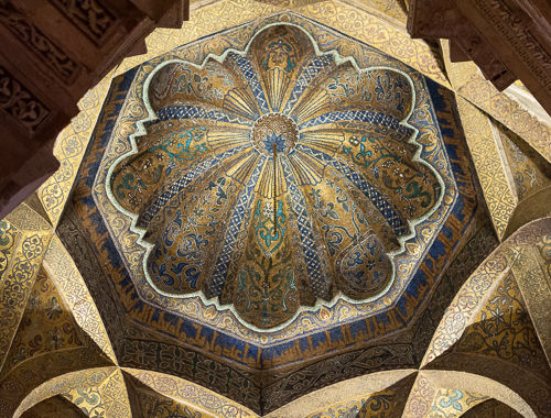 Blue and golden details in ceiling decoration.