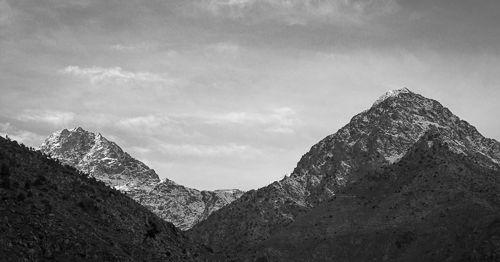 Sharp-edged and snow-covered mountain ridges near Jebel Toubkal.