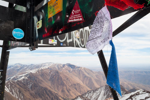 Nepalese prayer flags at the summit of Jebel Toubkal.