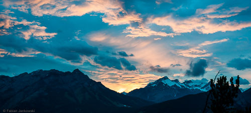 The skyline of the Canadian Rocky Mountains at sunset seen from Banff national park.