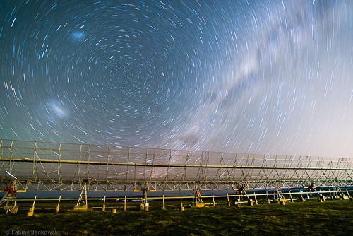 The Molonglo radio telescope in front of the Milky Way and the South Celestial pole.
