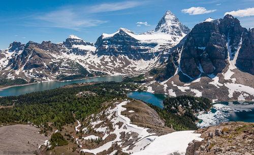 View of the Assiniboine Valley. From left to right: Lake Magog, Mt. Assiniboine, Sunburst Lake, Sunburst Peak and Cerulean Lake.