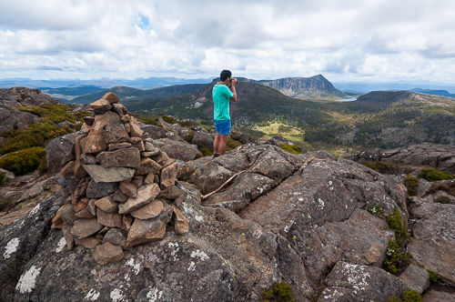 James takes a photo behind the summit cairn on Mt. Jerusalem.