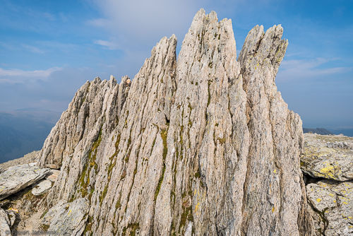 A jagged rock marks the otherwise flat summit of Glyder Fawr.