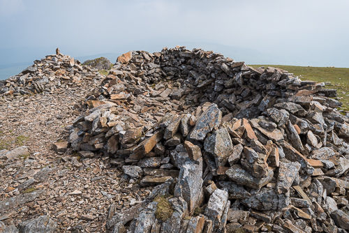 The summit of Mynydd Moel is marked by two stone structures, one of which could be used as a simple wind shelter.